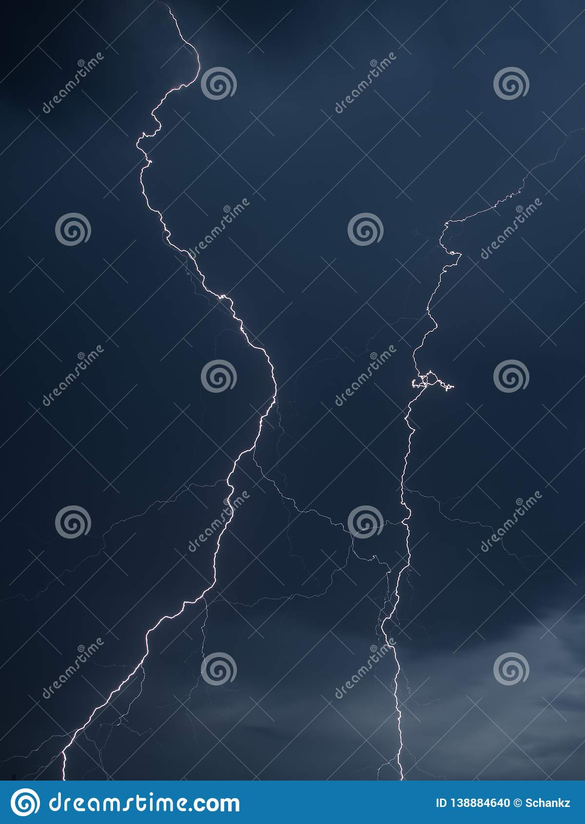 The discharge of lightning in the sky as a background