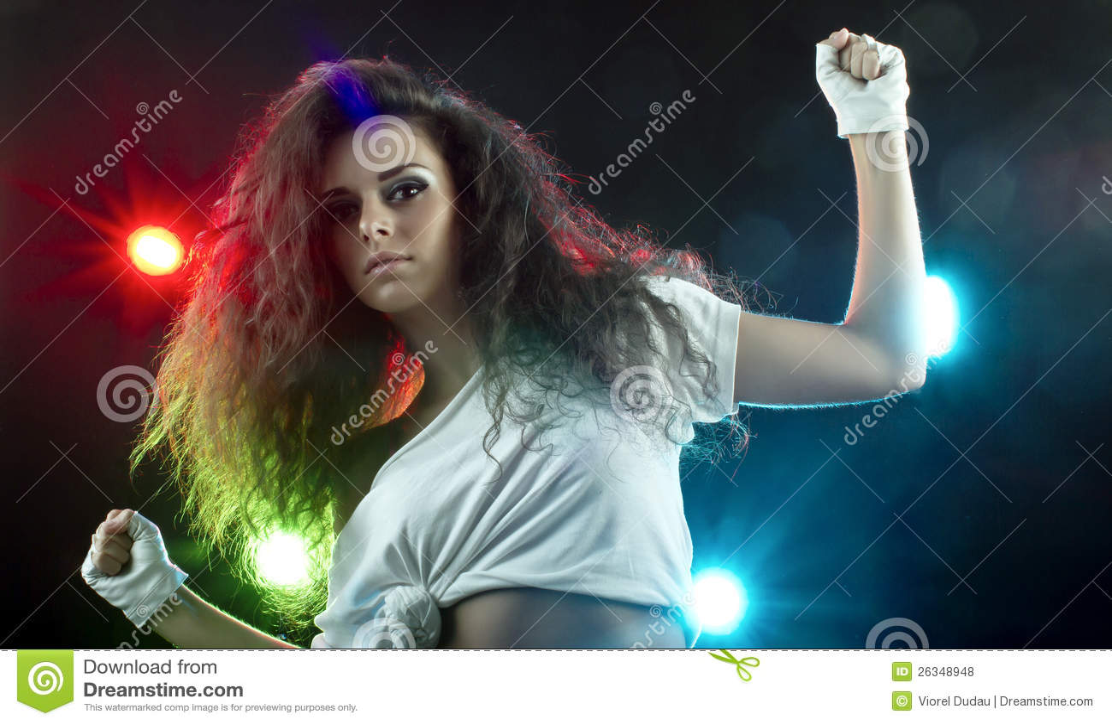Beautiful Woman Dancing in Disco Spotlights