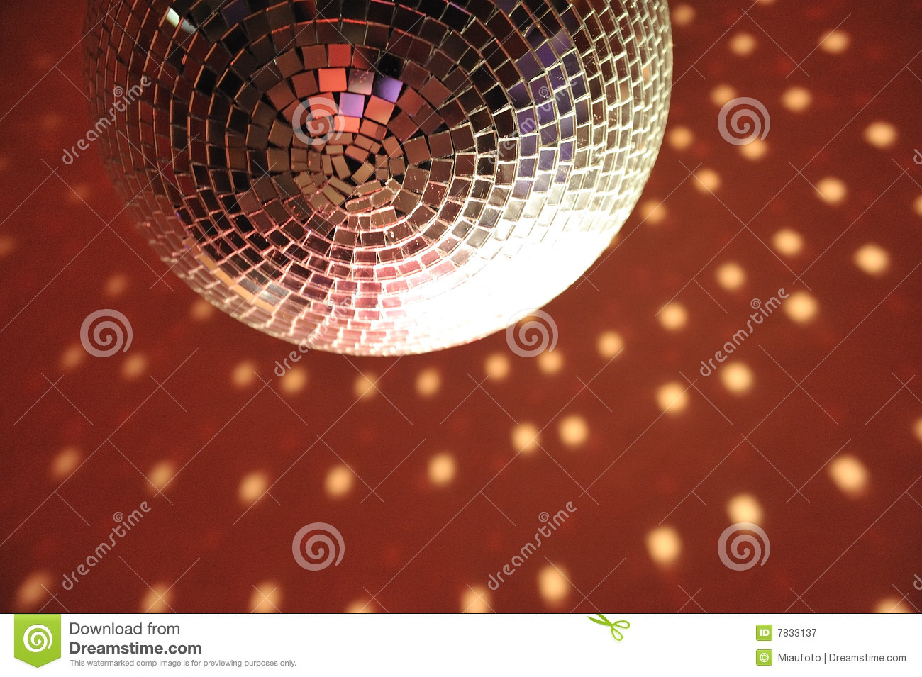 Discotheque light ball luminary on red ceiling