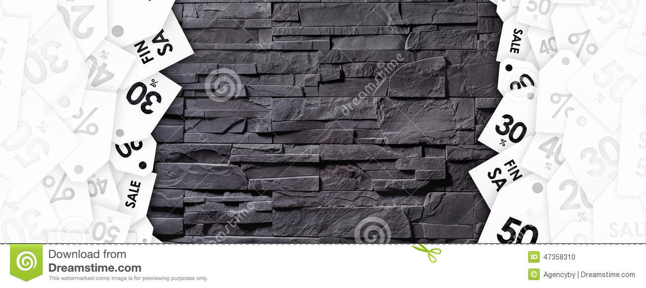 Discount tags on texture of stone wall
