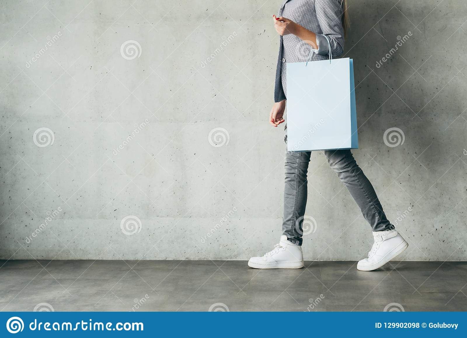 Discounts shopping spending woman holding bag