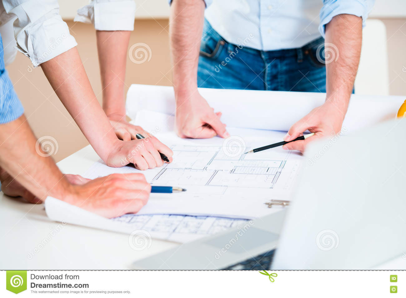 Discussion of construction plans in architects office stock image
