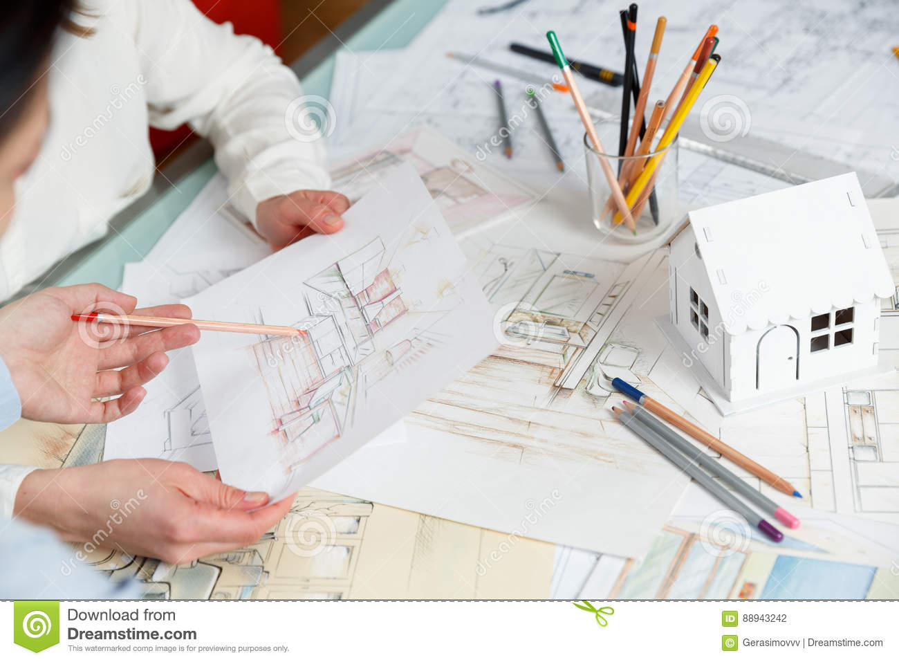 Interior Designers Working On Color Hand Drawings Of A Kitchen Interior At  Work Place. Photo Of Young Designers Work Concept
