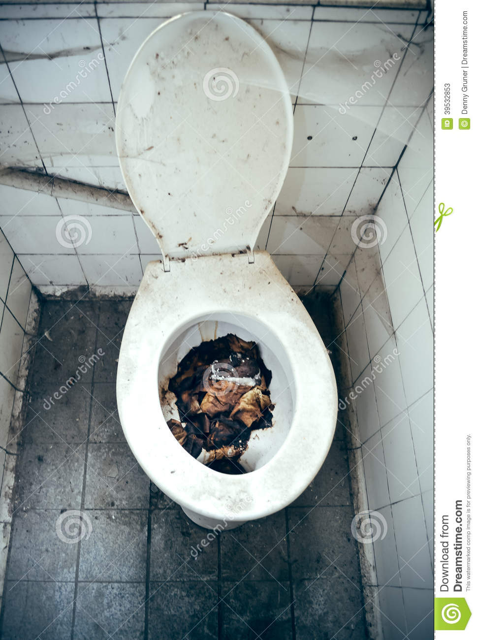 An old nasty clogged toilet with holding remains.