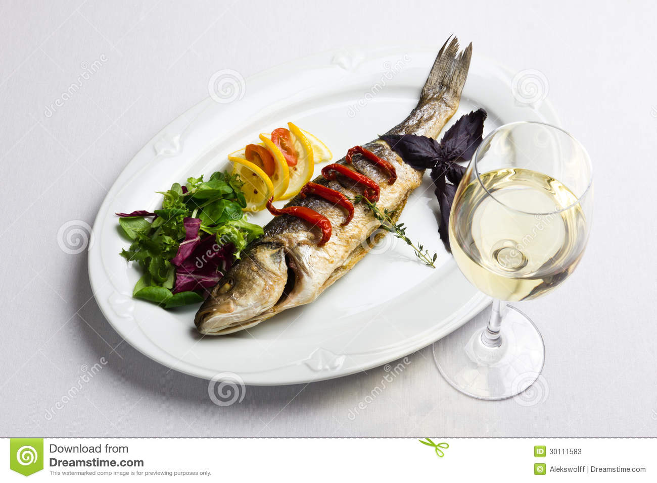 Dish with the baked fish and wine stock photos image for Red wine with fish