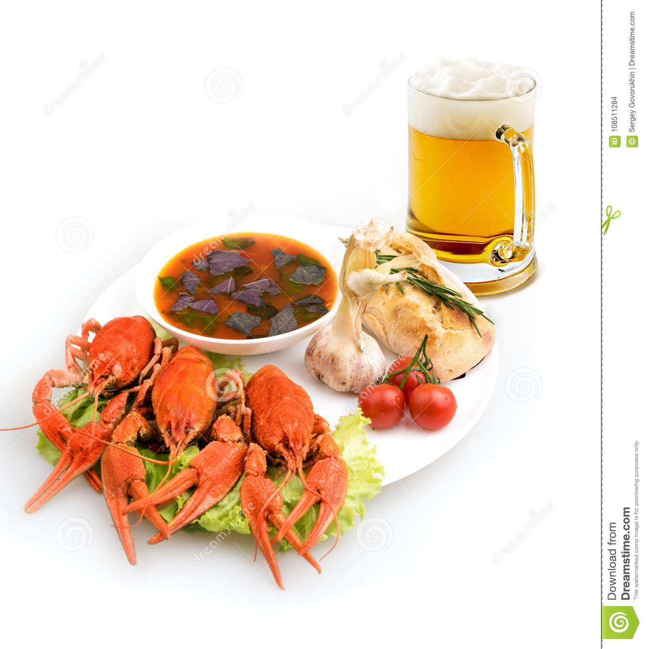 Dish cooked crayfish, soup and beer
