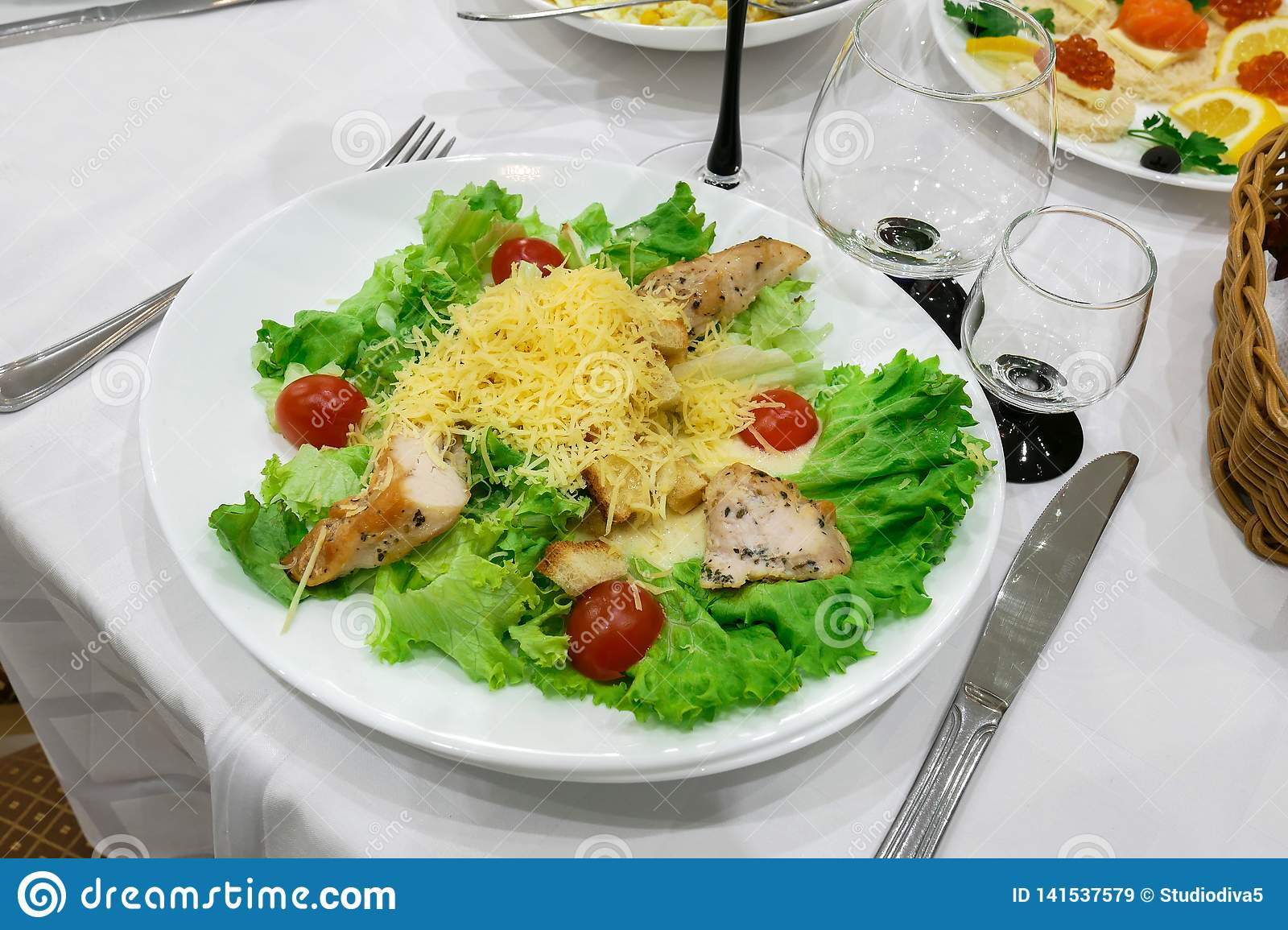 Dish in the restaurant. Green salt, potatoes and meat