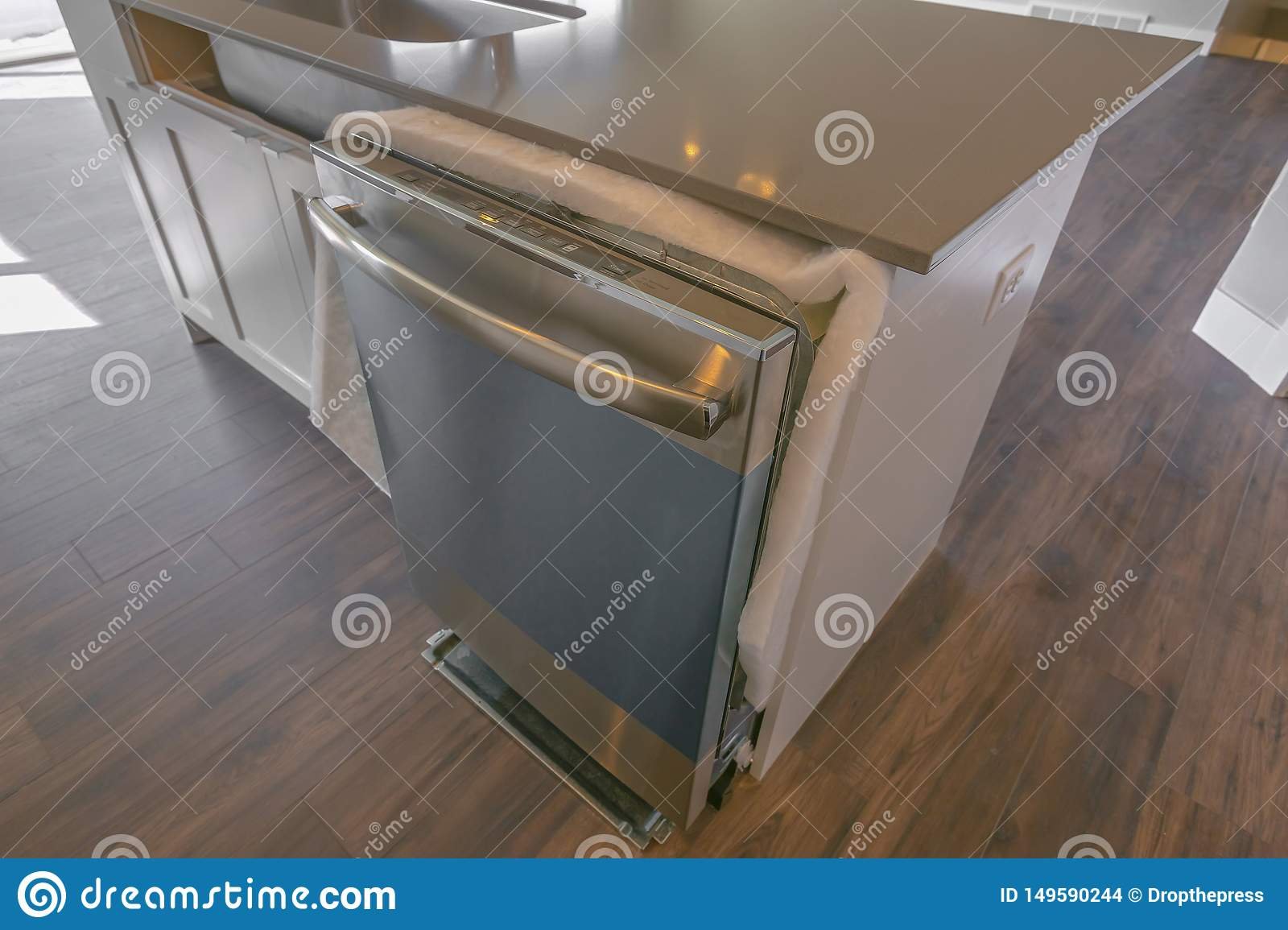 Dishwasher And Sink On A Kitchen Island With Glossy ...