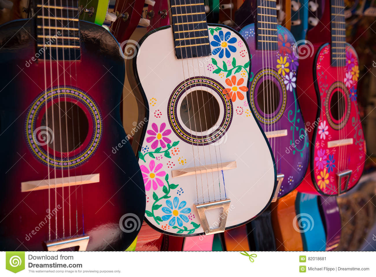 display of ornate small mexican made guitars stock image image of yellow musical 82018681. Black Bedroom Furniture Sets. Home Design Ideas