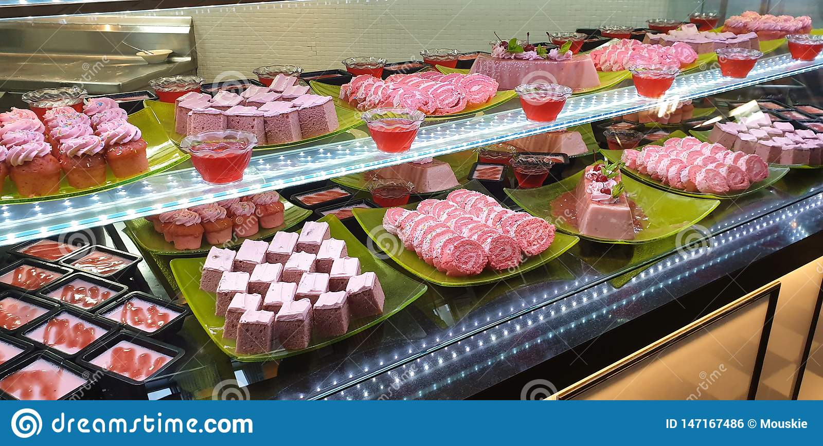 Display of pink cakes