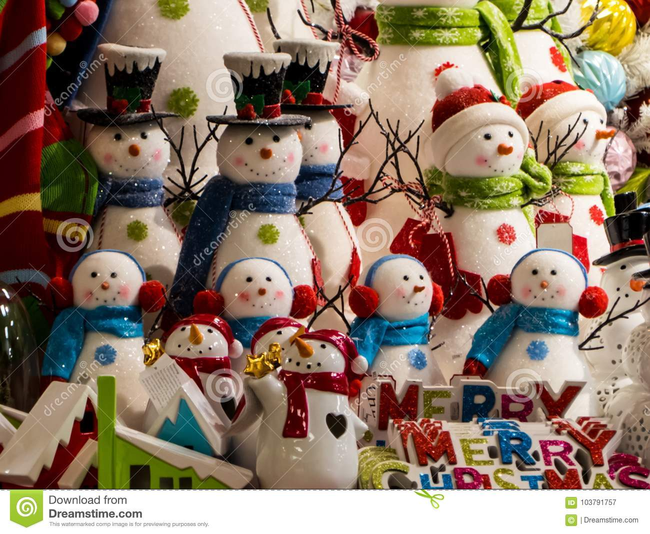 a display of snowmen displayed like christmas carolers