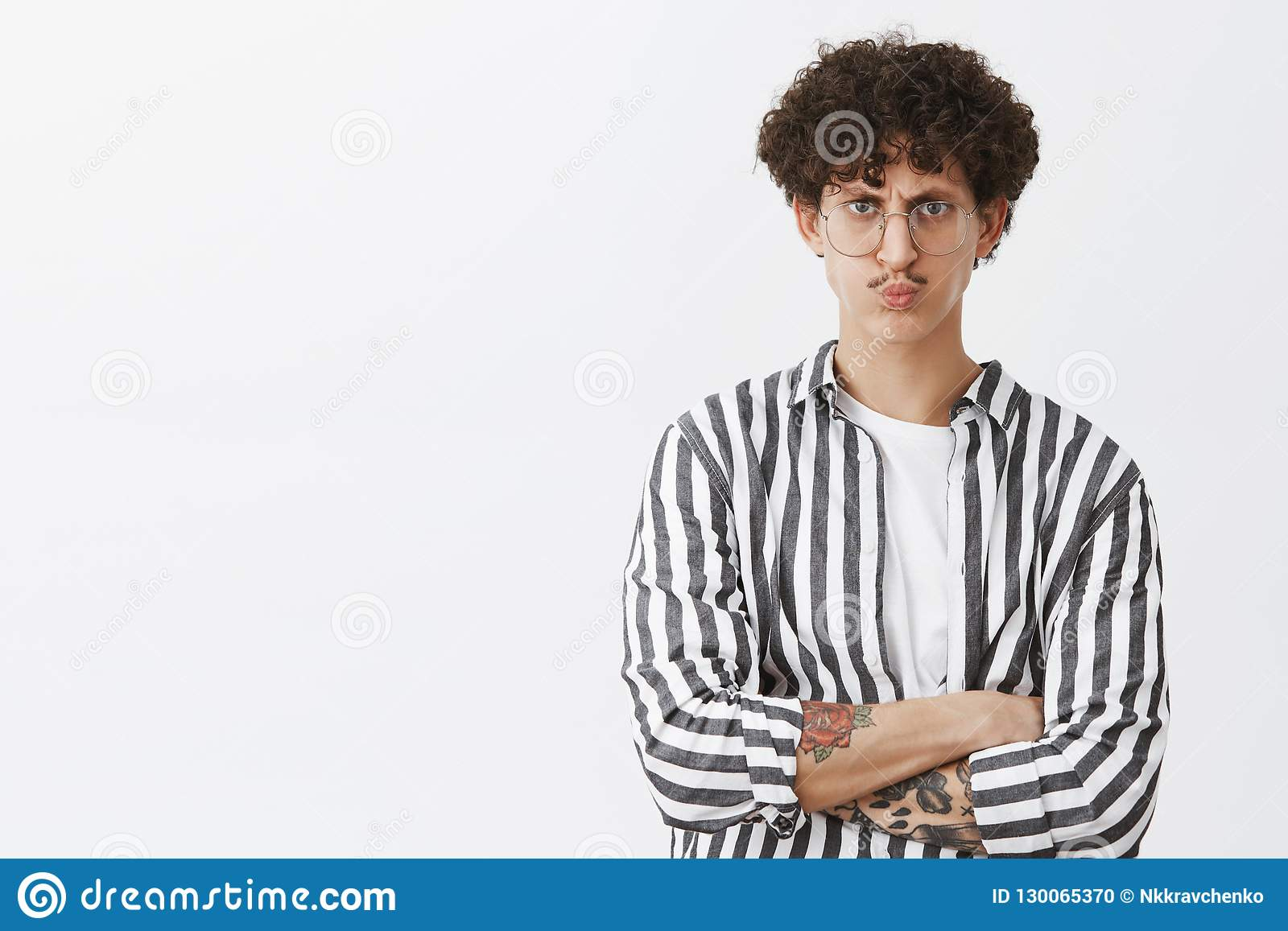 Displeased Concerned Stylish Male Entrepreneur In Striped