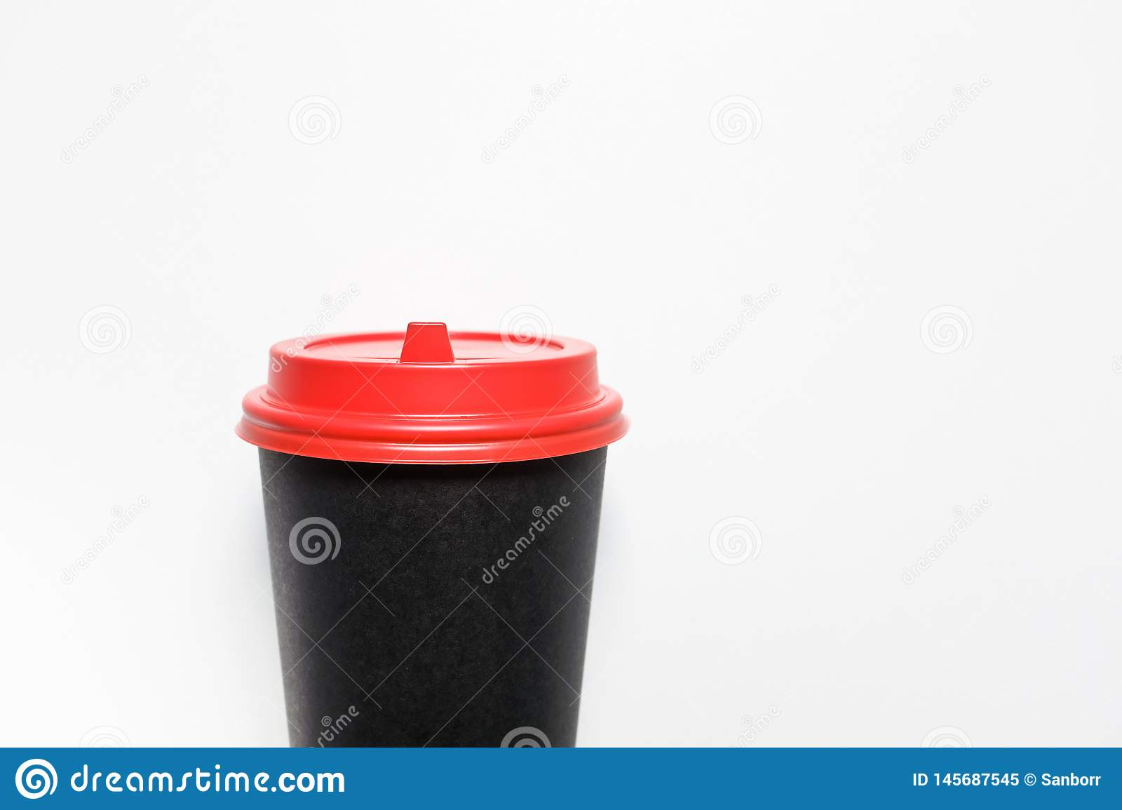 Disposable, paper Cup for coffee takeaway, with red plastic lid, isolated on white background, close-up