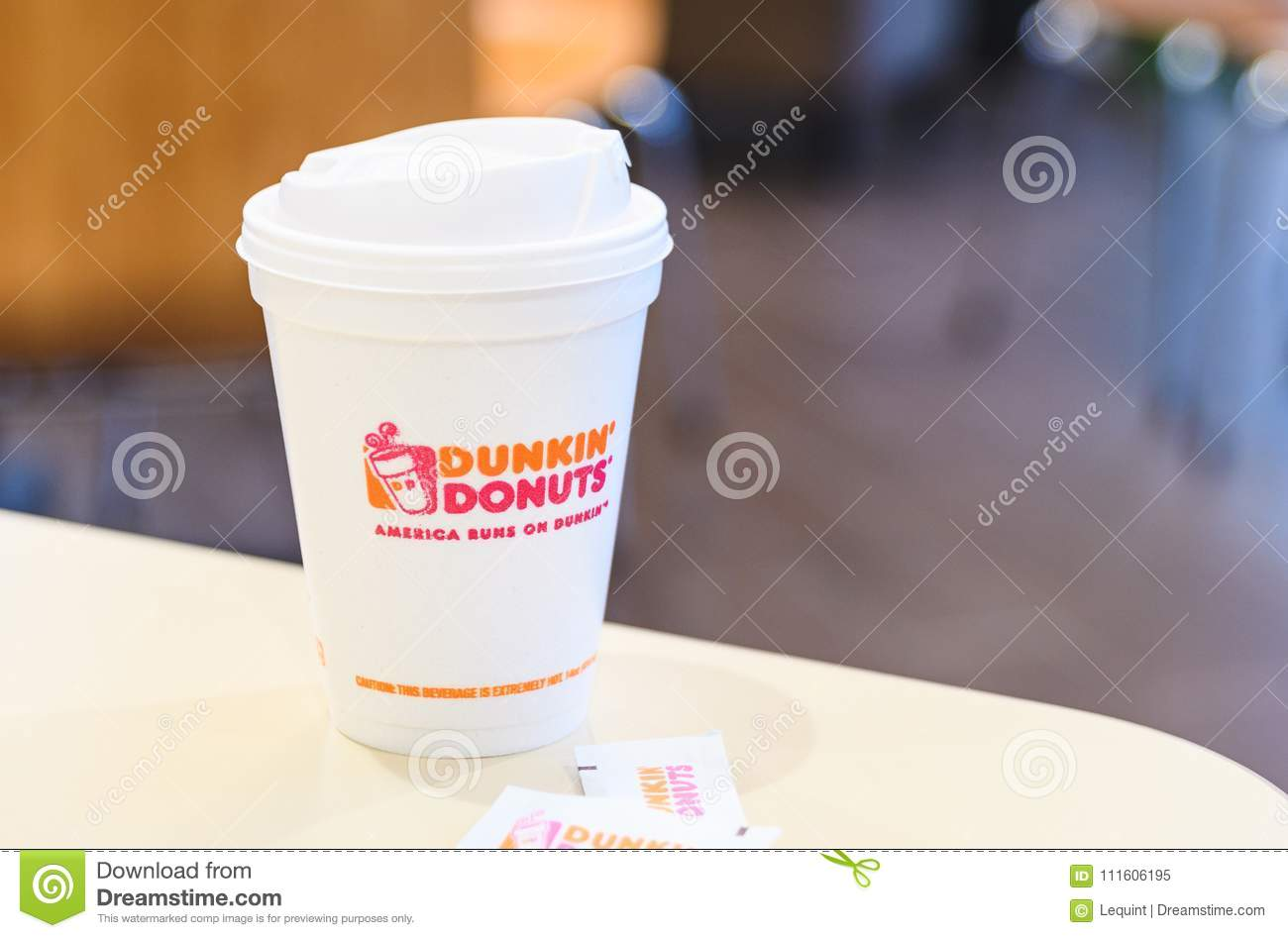 Dunkin Donuts Cup Of Hot Coffee And Sugar Sachet On Table Editorial Image - Image of packet