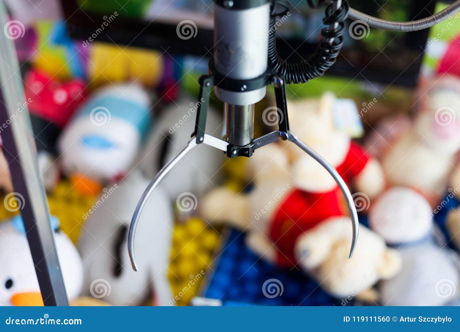 Dispositif de capture de grue de griffe en parc d attractions pour les enfants Jeu de receveur de jouet en parc d enfants Concept