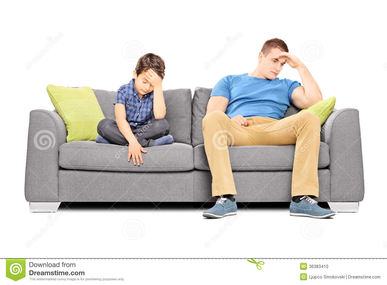 dissappointed brothers sitting on a sofa stock photo. Black Bedroom Furniture Sets. Home Design Ideas