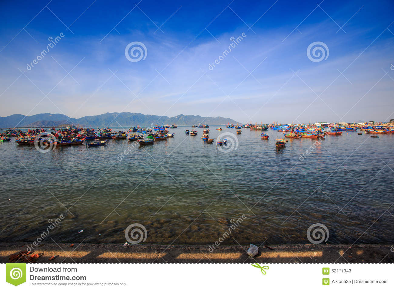 Distant Group Of Vietnamese Fishing Boats Against Hilly ...