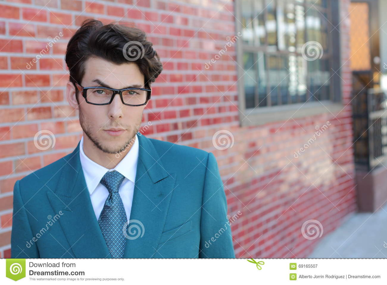 Distraught young businessman with raised eyebrow on the street