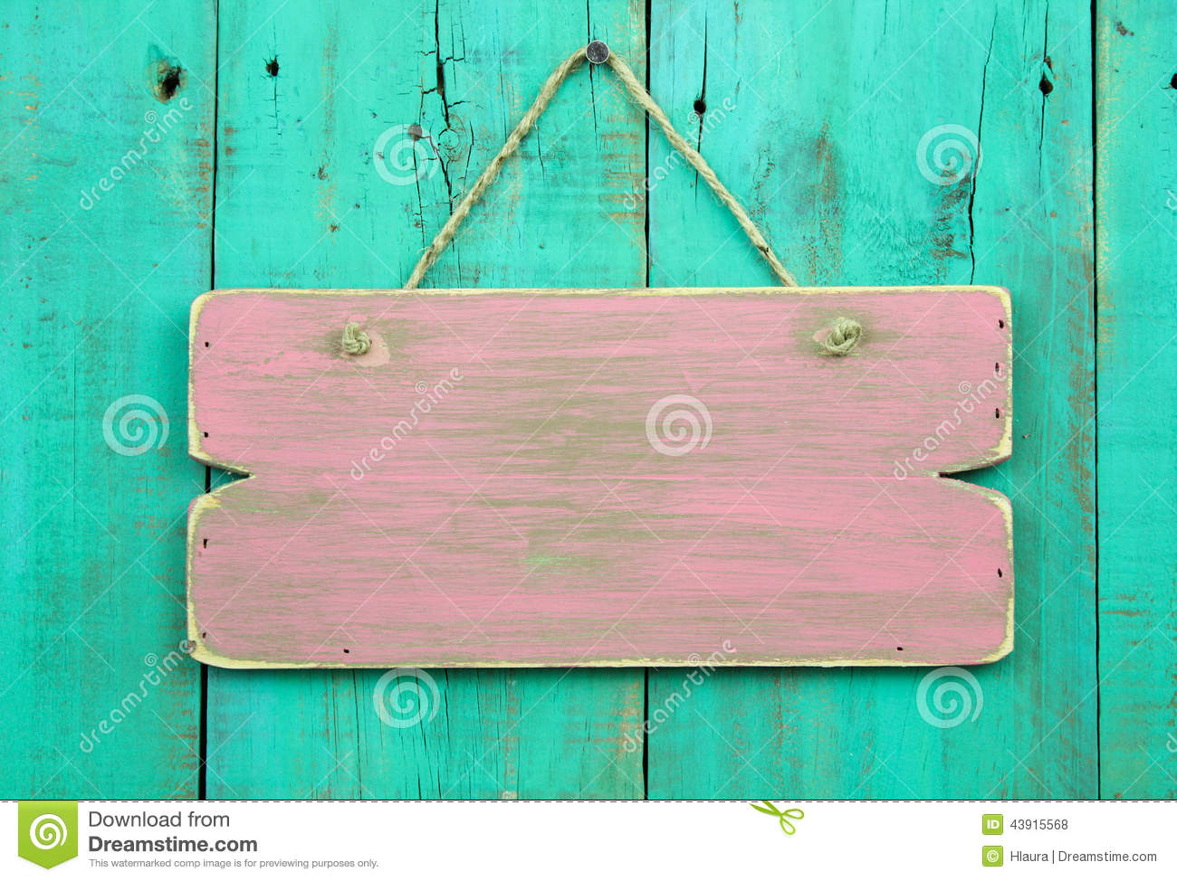 Distressed Pink Blank Sign Hanging On Antique Green Wooden