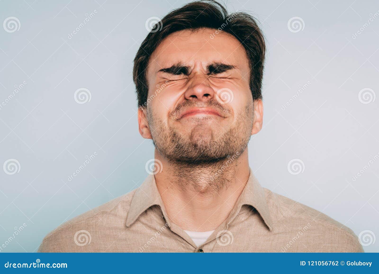 facial grimacing Painful