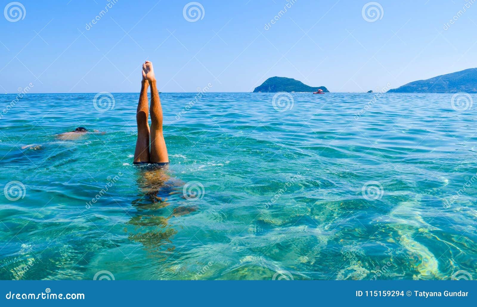 Dive into the sea.