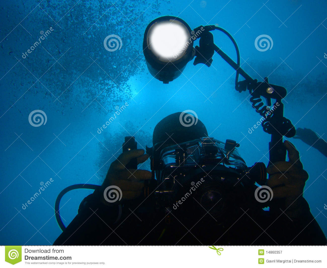 Diver with underwater camera and light