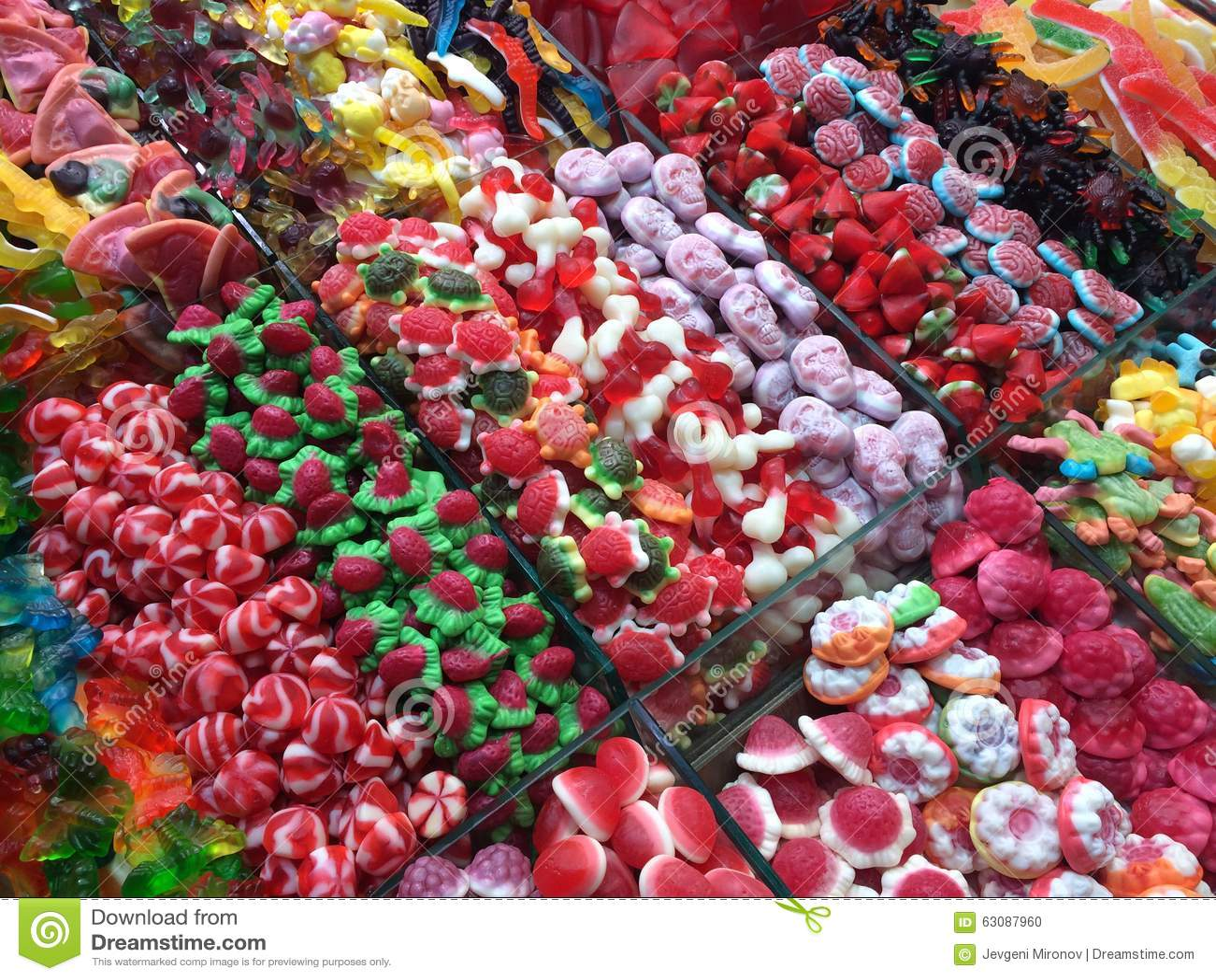 Download Divers bonbons colorés photo stock. Image du personne - 63087960