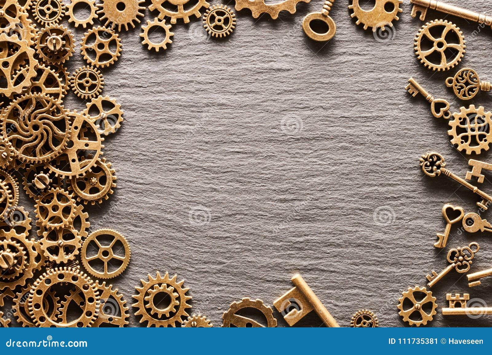 Diversas ruedas dentadas del metal, ruedas de engranaje y llaves