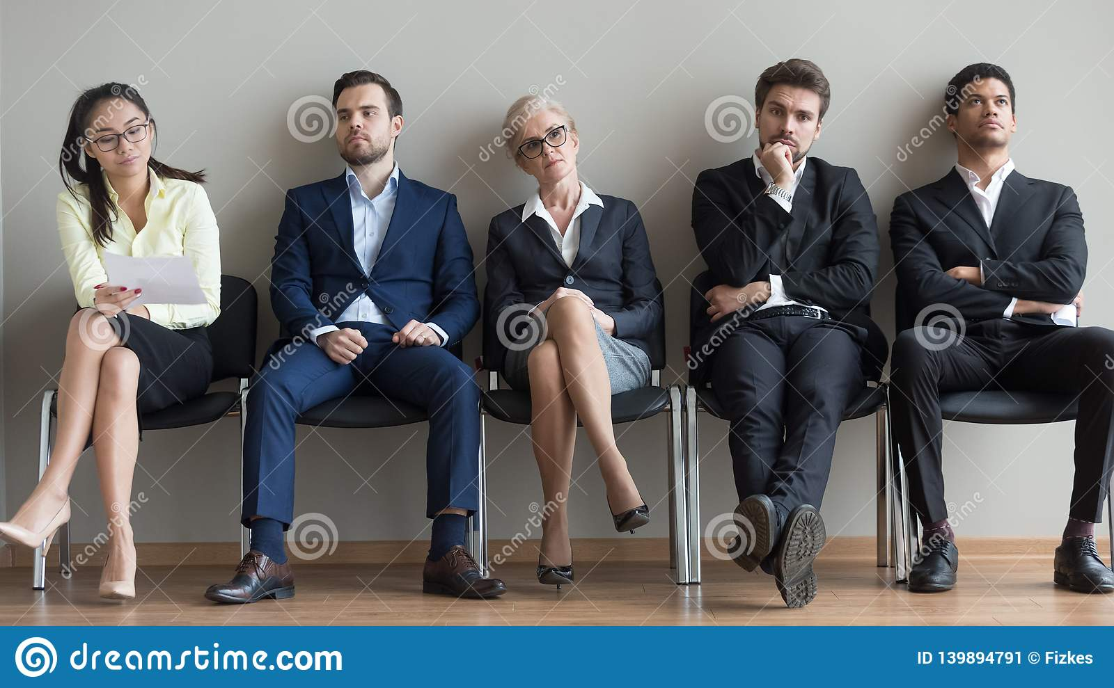 Diverse applicants waiting for their turn preparing for job interview