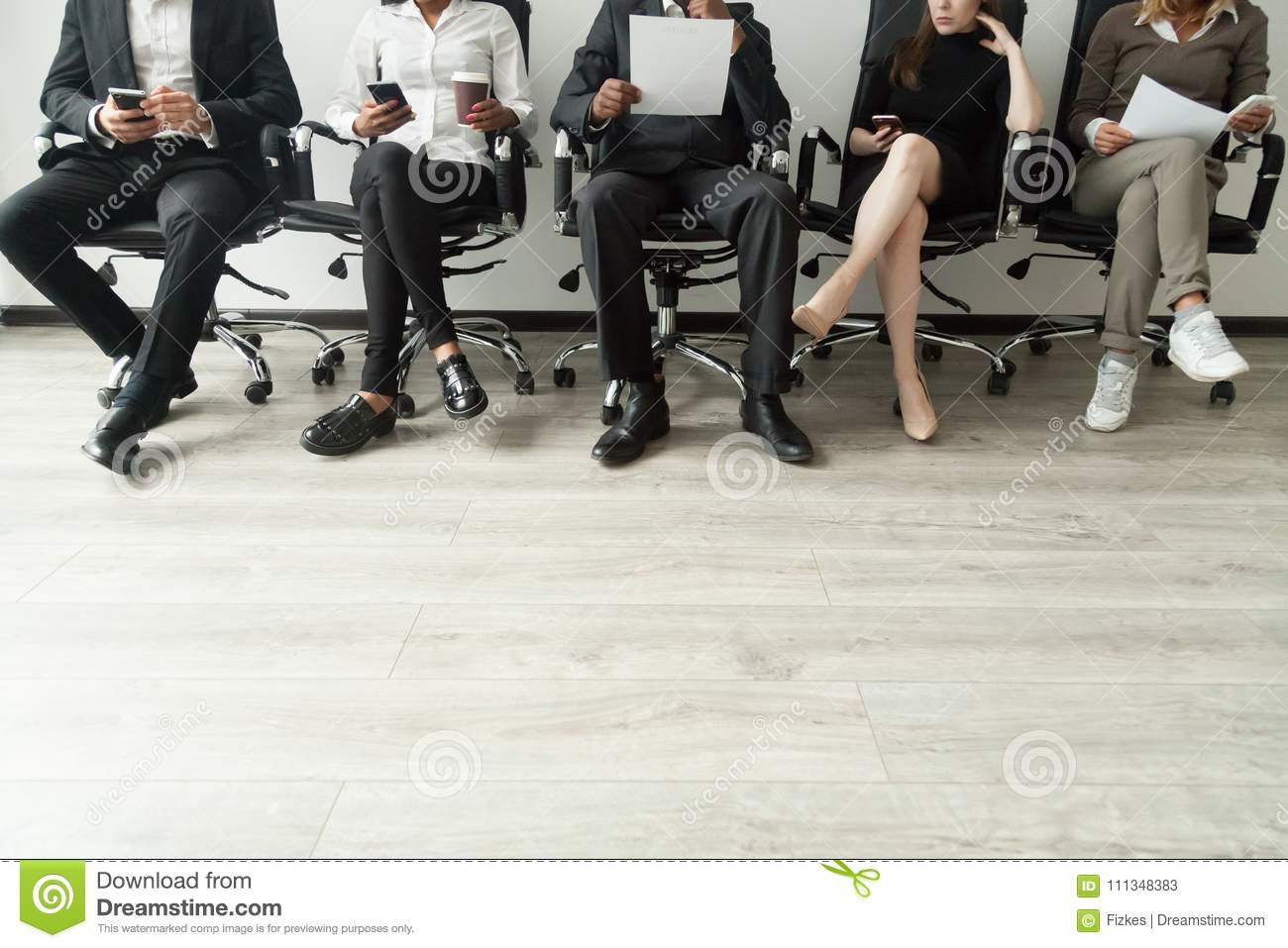 Diverse business people waiting in queue holding smartphones and