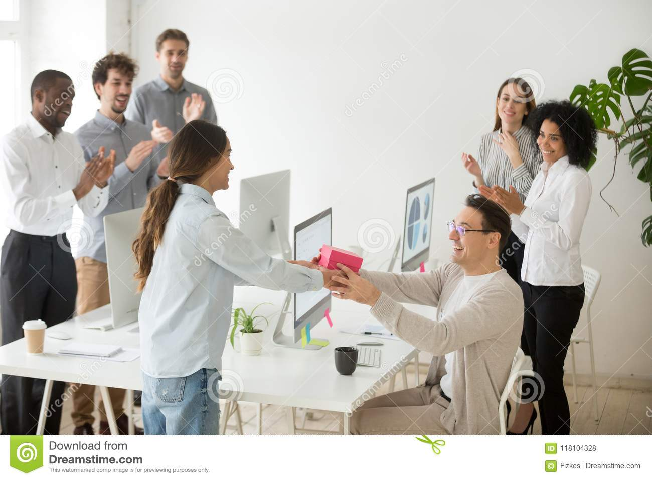 Smiling Female Employee Congratulating Colleague With Birthday Presenting Gift Box Diverse Coworkers Greeting Happy Male Manager Applauding And Making