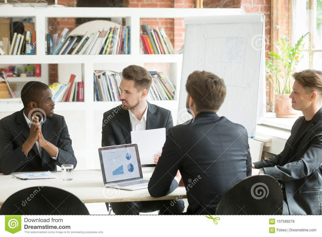 Diverse executive business team discussing work results at corpo