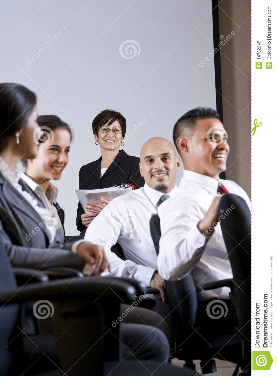 Diverse group businesspeople watching presentation