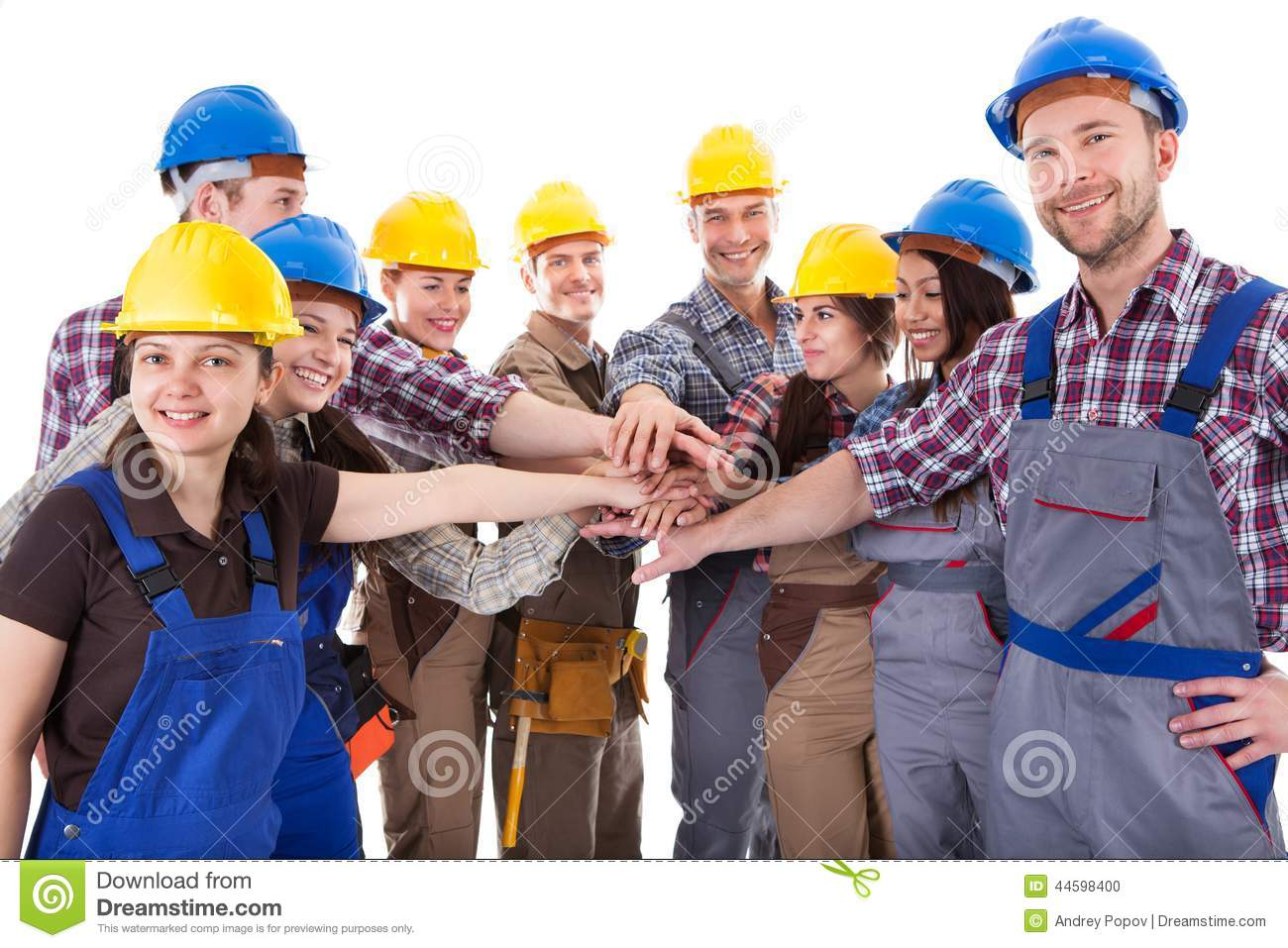 Diverse Group Of Construction Workers Stacking Hands Stock