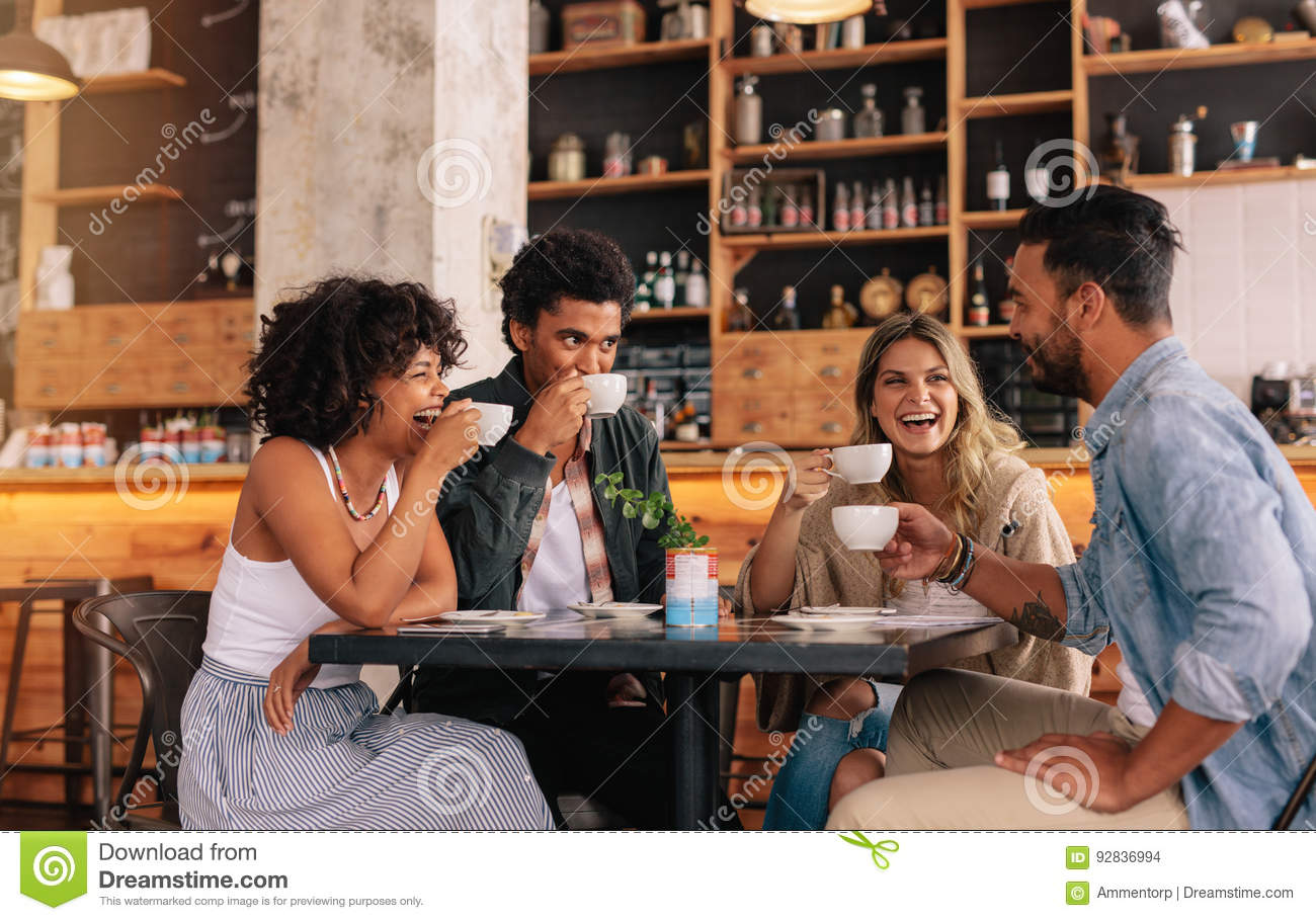 Diverse group of friends enjoying coffee together
