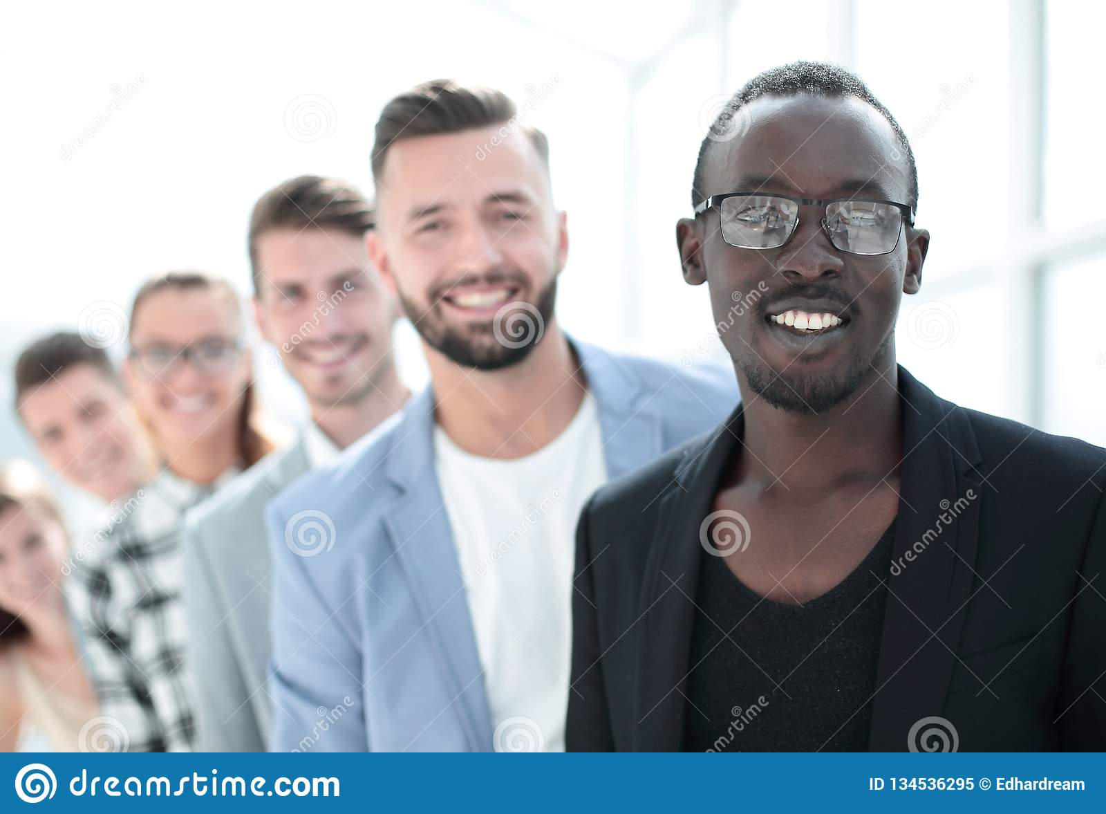 Portrait of creative team standing in the office. Diverse group of people standing in row. Isolated on white royalty free stock photo