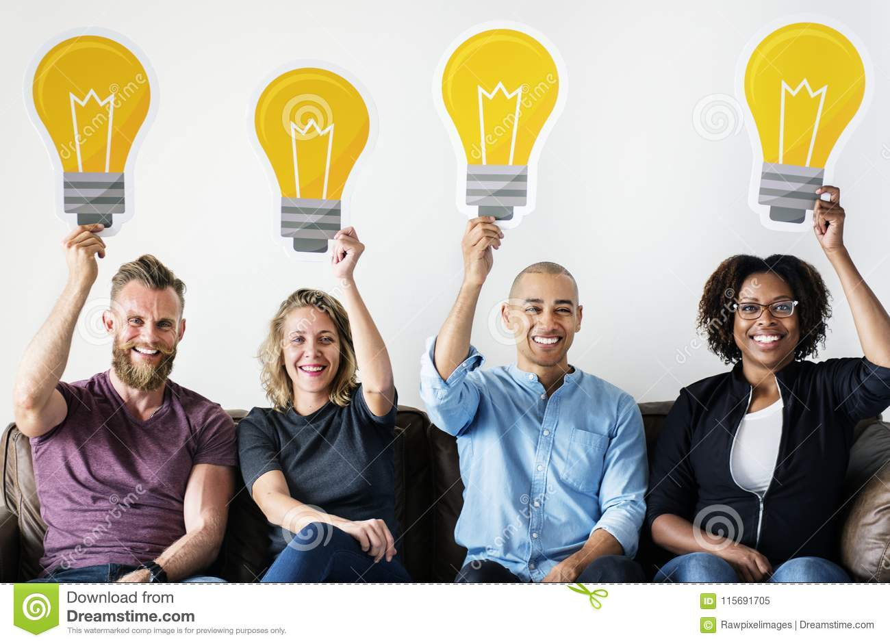 Diverse people carrying light bulb icons