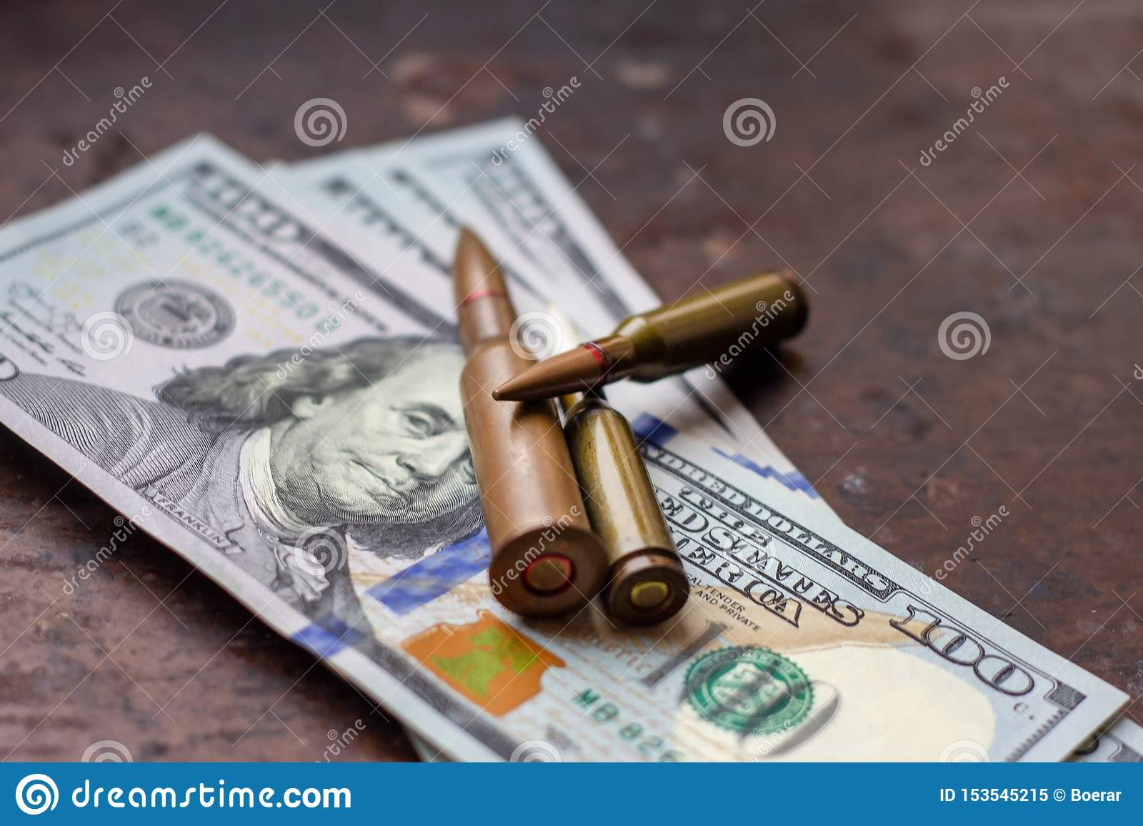 Diverse weapon bullets on American dollars background. Military industry, war, global arms trade and crime concept.