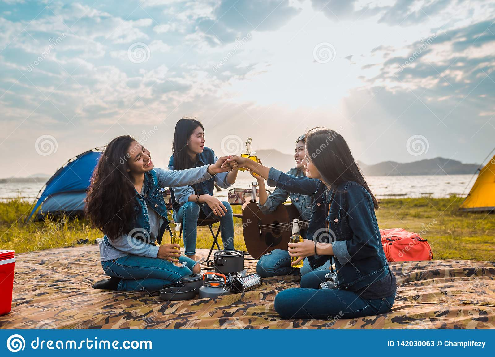 Diversity women party clink bottles enjoy camping