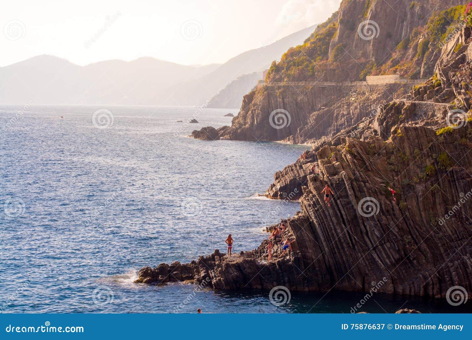Diving from Riomaggiore cliffs