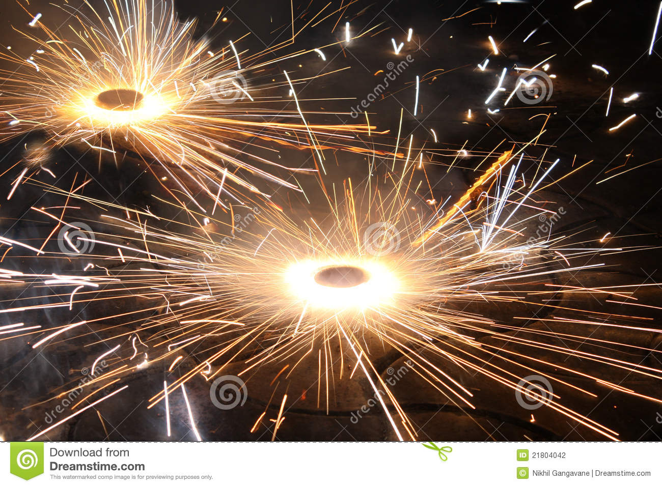 type of firework/cracker rotating on the ground, during the Diwali ...