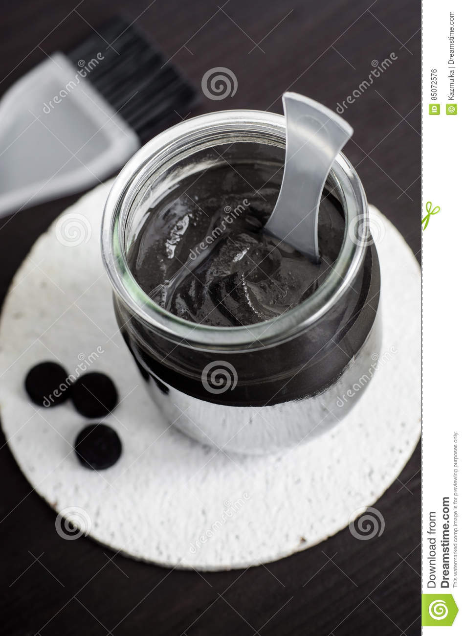 DIY charcoal face mask in a glass jar. Homemade cosmetics.