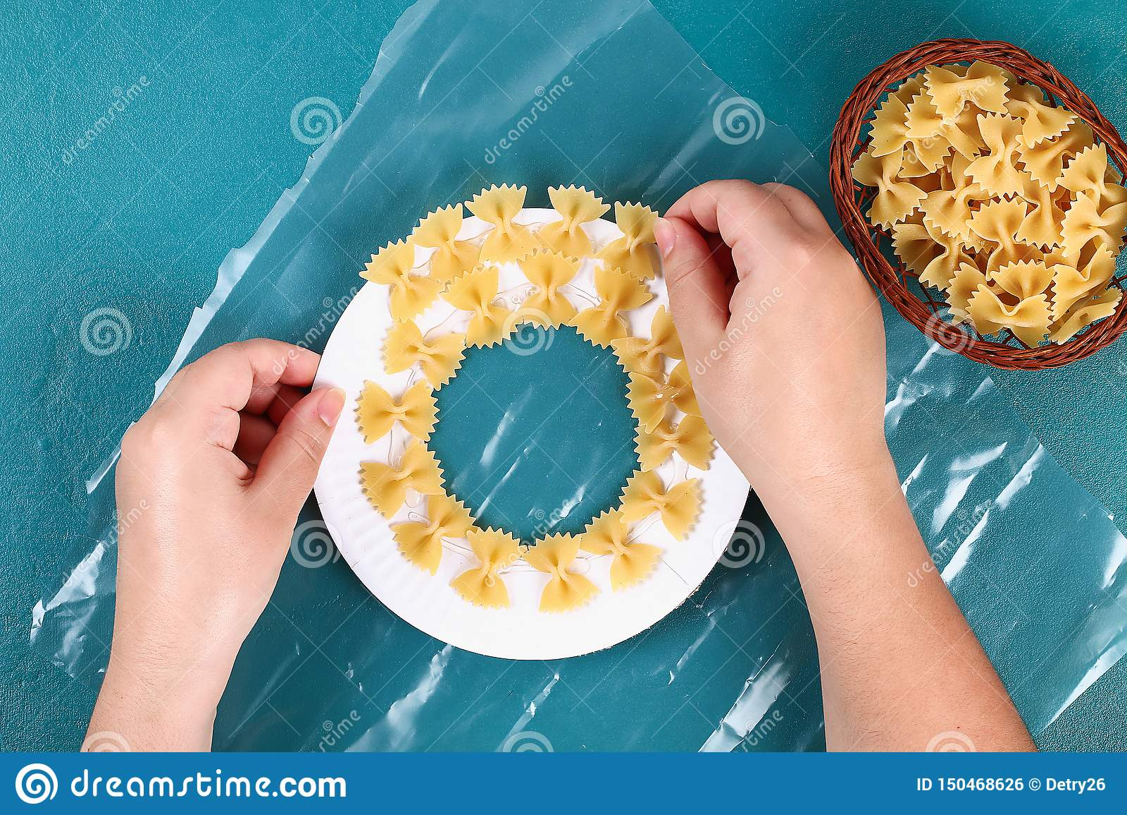 Diy Christmas pasta wreath on blue background. Gift idea, decor Christmas, Xmas, New Year