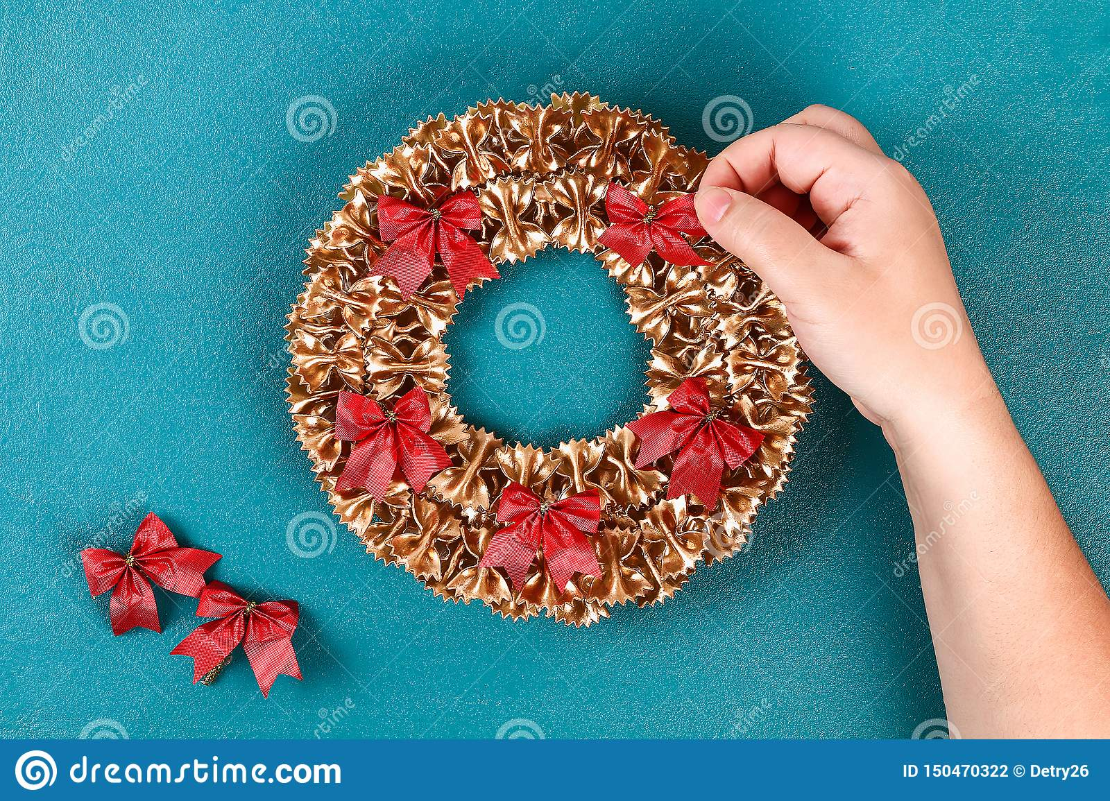 Diy Christmas pasta wreath on blue background. Gift idea, decor Christmas, Xmas, New Year