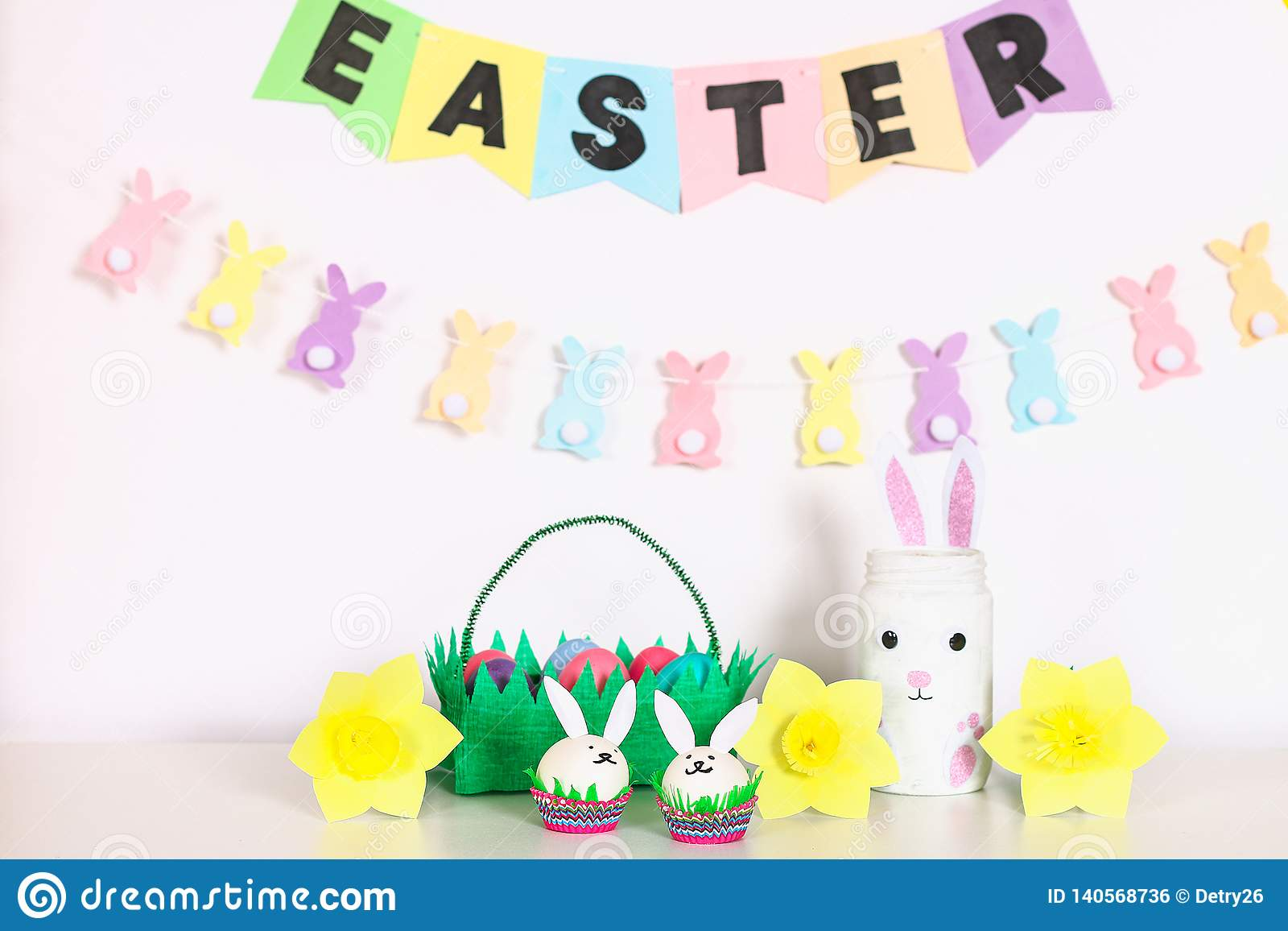 Diy decor for Easter. Paper garlands, vase bunny, daffodils, eggs bunnies, basket with painted eggs