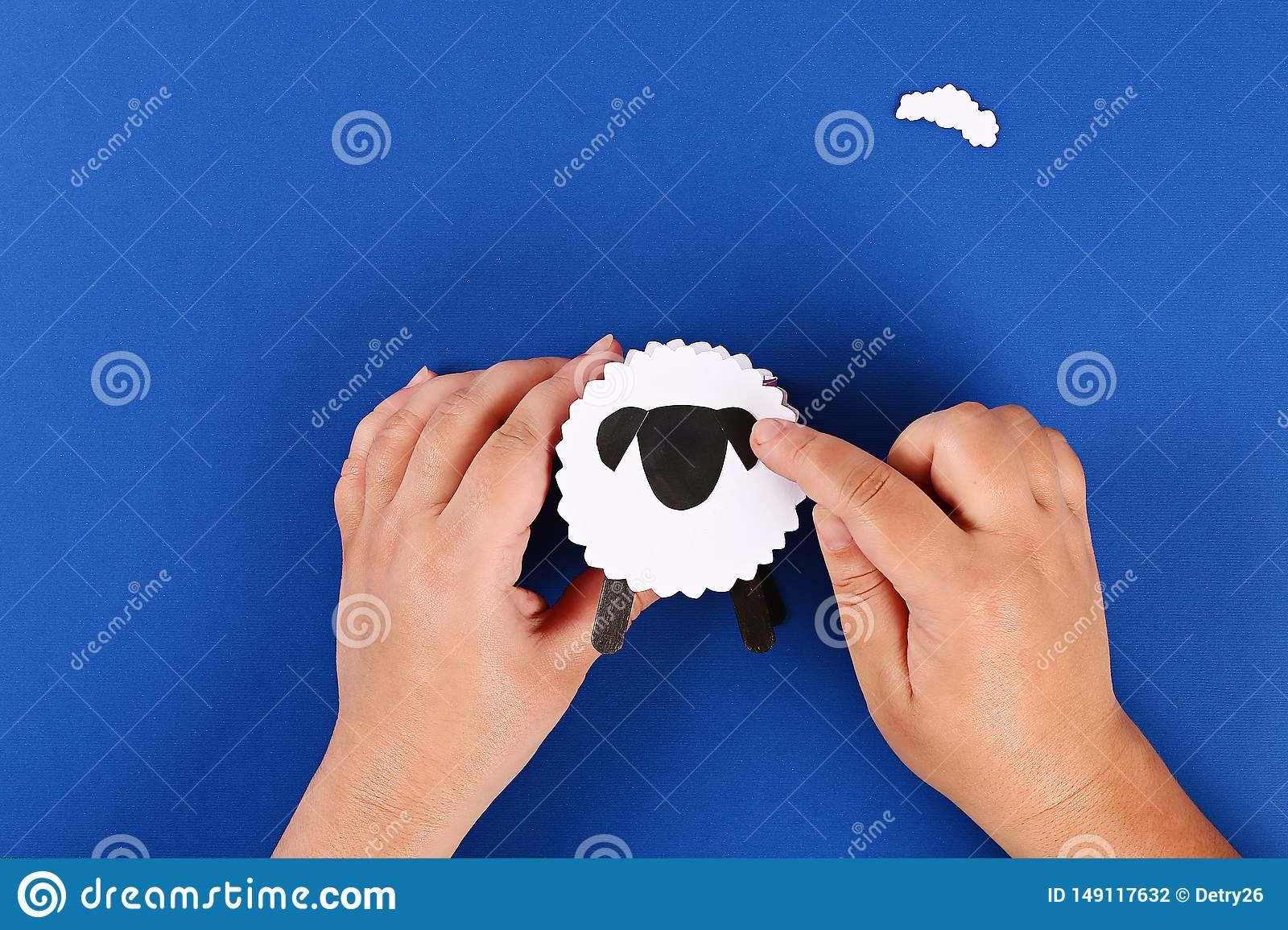 Diy Eid al adha lamb sheep sweet candy paper, wooden sticks for ice cream on blue background