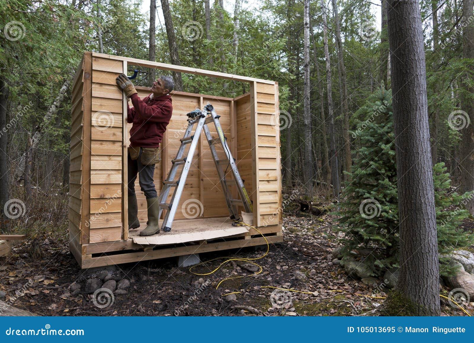 Handyman Building A Cedar Storage Shed Stock Image - Image