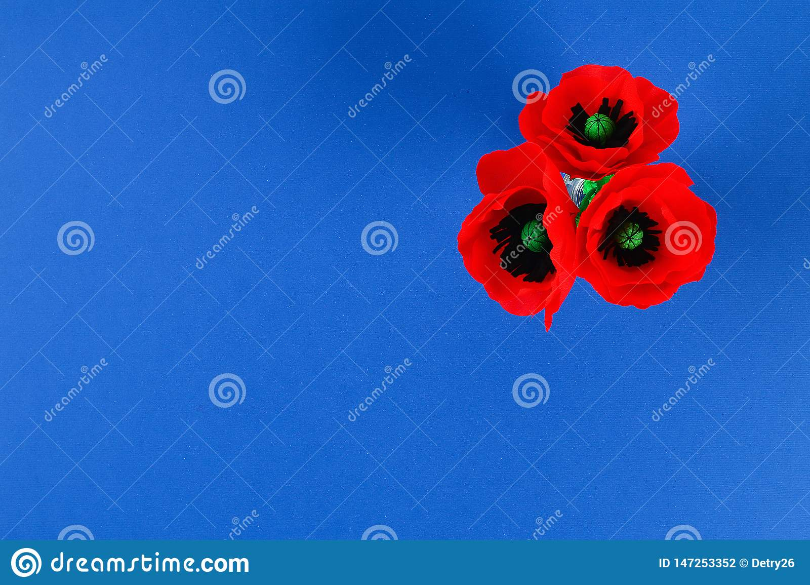 Diy paper red poppy Anzac Day, Remembrance, Remember, Memorial day crepe paper on blue background