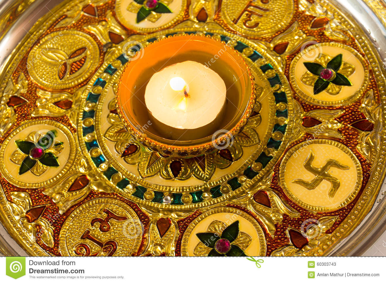 Diya lamp on a decorated golden plate stock photo image