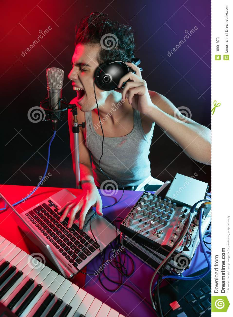 dj with colorful light and music mixing equipment stock photos image 10901873. Black Bedroom Furniture Sets. Home Design Ideas